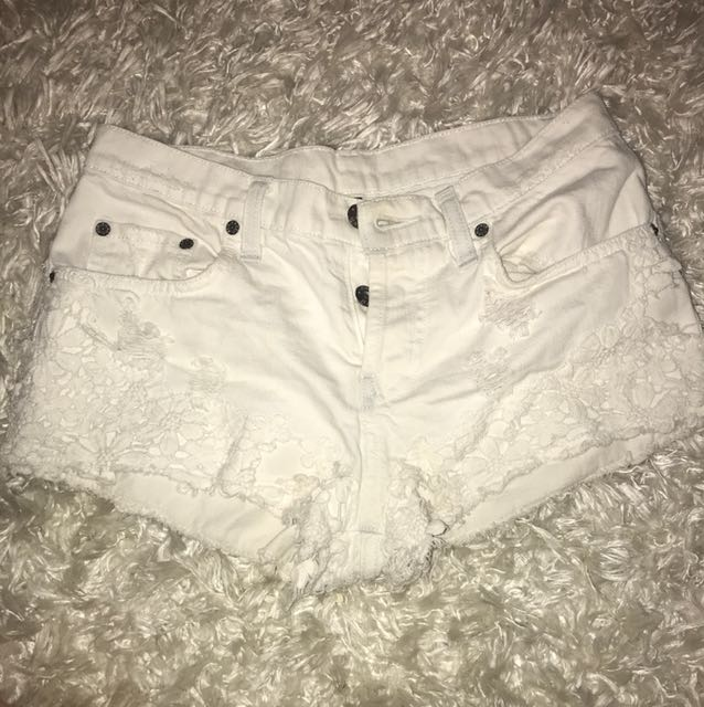 White distressed shorts with flower detail!!