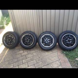 Nissan tiida set of 4 wheels & tyres