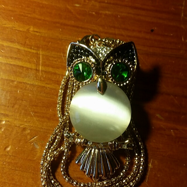 Beautiful owl necklace with emerald eyes