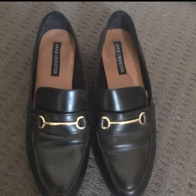 Black and gold loafers
