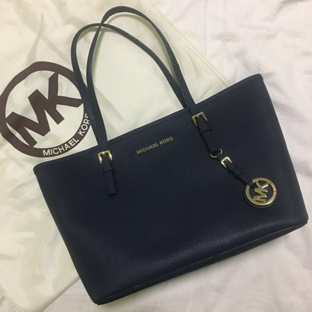 a8fbfc7923287c Michael Kors Jet Set Travel Saffiano Leather Small Tote - Color Navy,  Women's Fashion, Bags & Wallets on Carousell