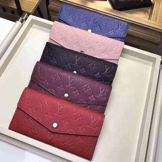 Louis Vuitton LV Sarah Wallets. Empriente Leather