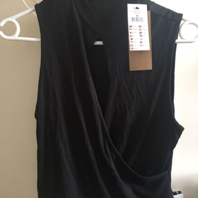 BNWT cotton on black wrap top size m