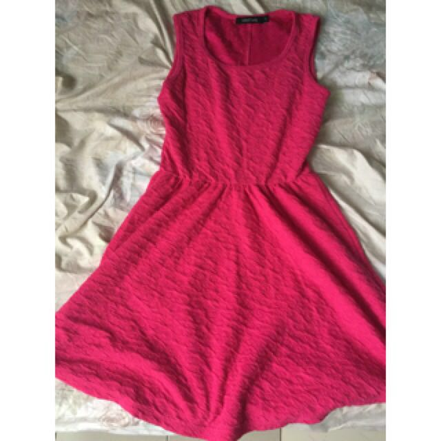 Folded and hung pink dress