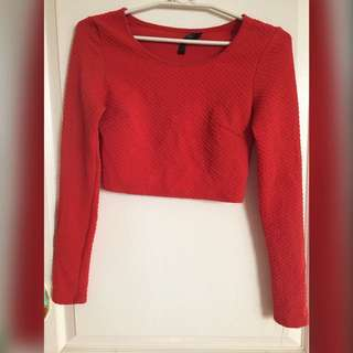 Red-orange crop top with long sleeves