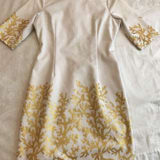 White dress with gold prints