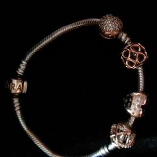 Rose Gold Pandora bracelet with 4 Rose Gold Charms.