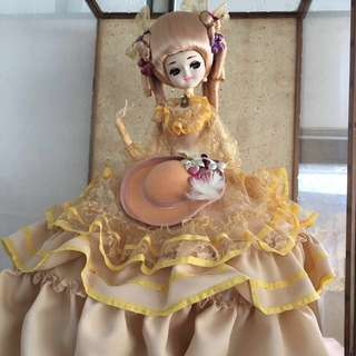 Collectible Doll in glass