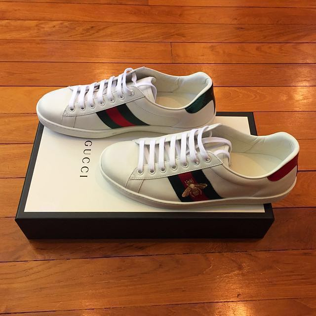 e70c00a7bc0 Gucci Ace bee-embroidered leather sneakers