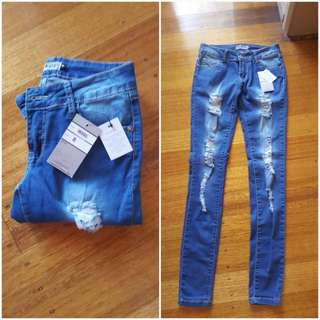 Ripped Jeans size 8