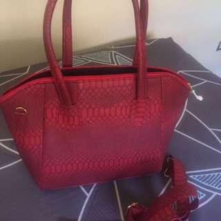 Red shoulder bag with sling strap