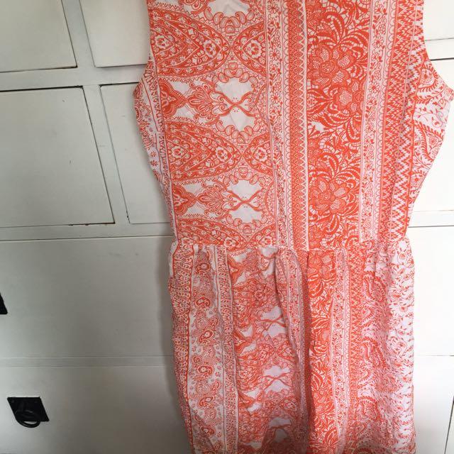 Bright orange pattern dress