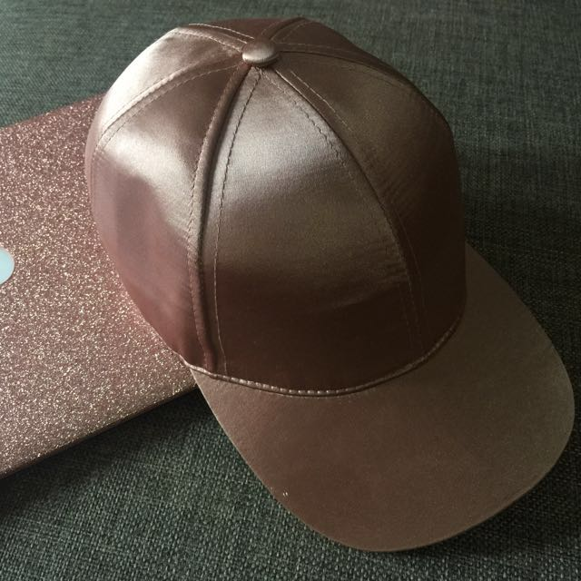 H&M rose gold cap