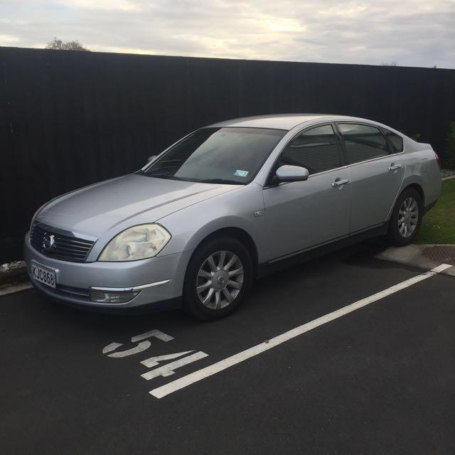 Silver Nissan Maxima