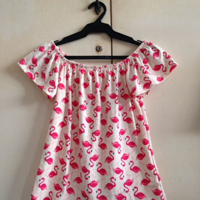 White off-shoulder top with pink flamingos print