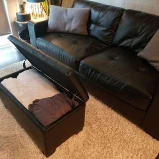 Black leather 2 seater sofa and ottoman with storage