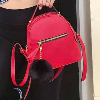 Red small backpack with free fluffy chain