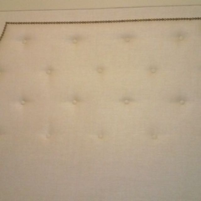 Cream upholstered Queen Headboard With Bronze Nail heads