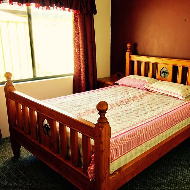 Queen Size Bed With Side Table And A Chest