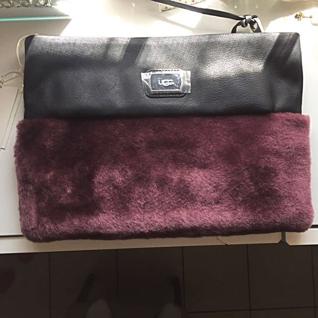 Reduced! Ugg clutch / bag with strap