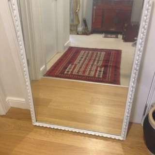 Hanging white mirror