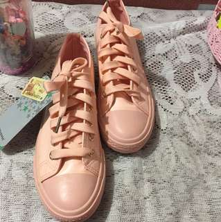 Pink leather Converse