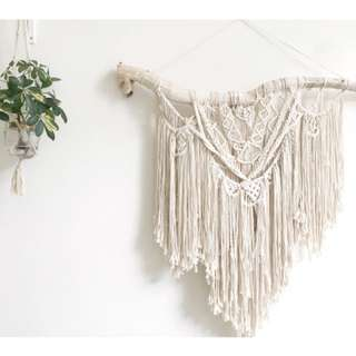 Handmade macrame on distressed wood