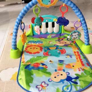 Preloved Fisher Price kick n' play piano gym