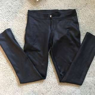 Black shiny stretch pants with back pockets size 8