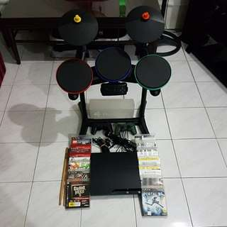 PS3 with drum with games and mic. Controllers are defective from not being used for a long time. The consile itself is in perfect condition.