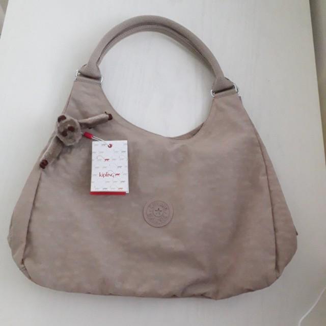 02e0be6c5 Kipling Bagsational Shoulder Bag Caffe Latte, Women's Fashion, Bags &  Wallets on Carousell