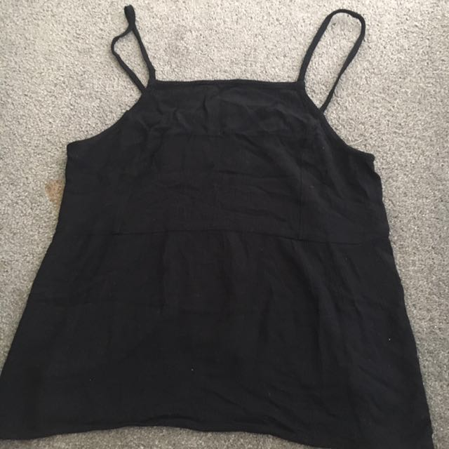 Styled black singlet