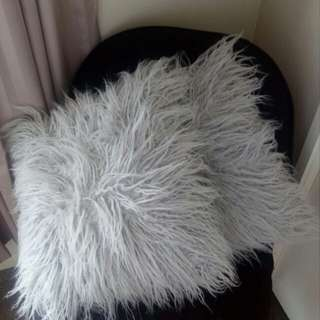 Grey fluffy cushions (x2)