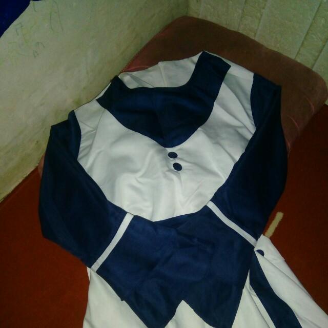 Gamis putih biru bahan baloteli.