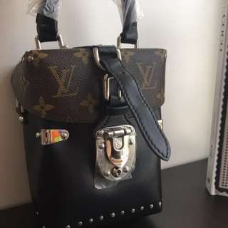 Half print studded lv bag