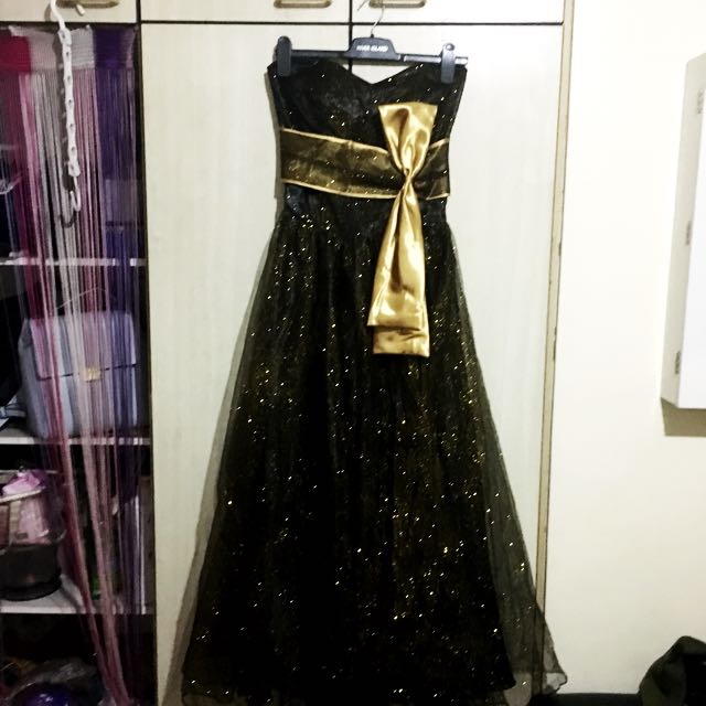 Black and gold glitter ball gown