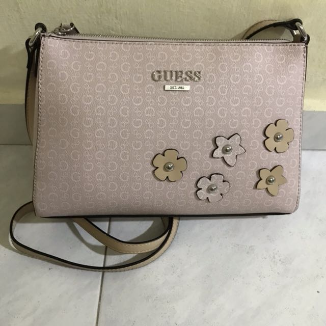 f354c2d355 Guess light pink sling bag with sewed on flowers