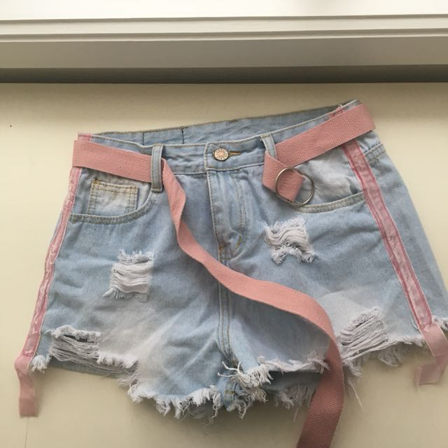 Light blue shorts with pink belt