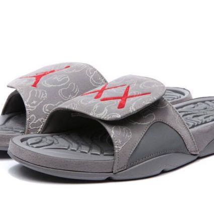 purchase cheap af0e8 58c47 SANDAL KAWS X AIR JORDAN 4 COOL GREY SLIDE SANDALS GLOW IN THE DARK ...