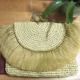 Woven envelope clutch with long strap