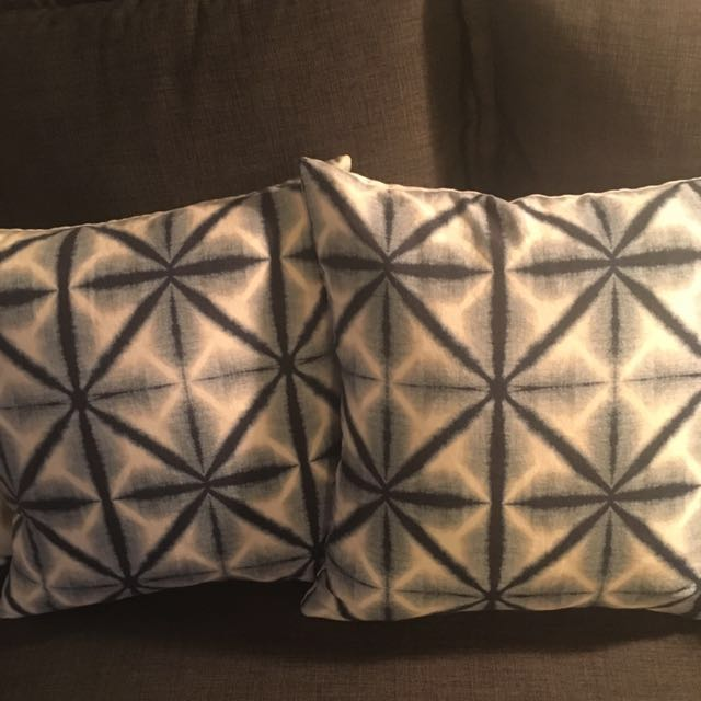 2 shibori printed throw pillows with feather inserts