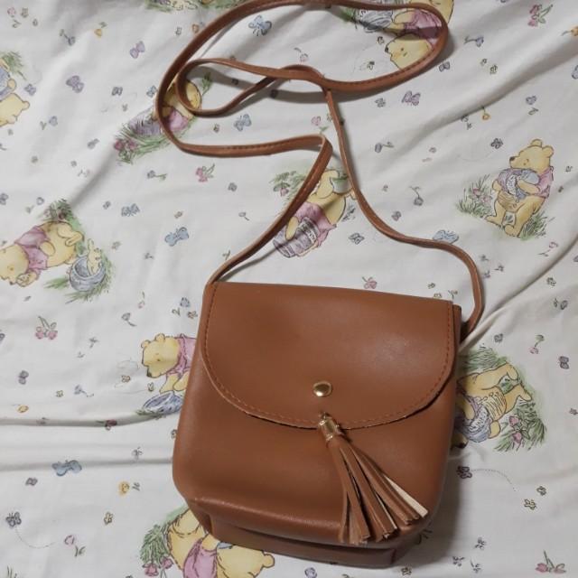 e1a578e6ef Sling Bag with Tussle