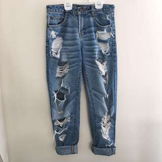 High-waisted distressed jeans size 27 (3-4 US)