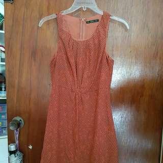 Size 8 sleeveless burnt orange black poka dots dress