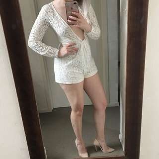 Stunning low cut white lace playsuit