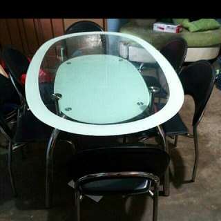 2 layered glass dining table set