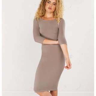 A beautiful taupe  body con dress hugs your curves . Looks amazing on