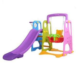 Children slide and swing with basket ball play net