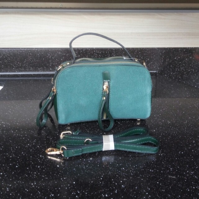Emerald green sling bag imporr stuff