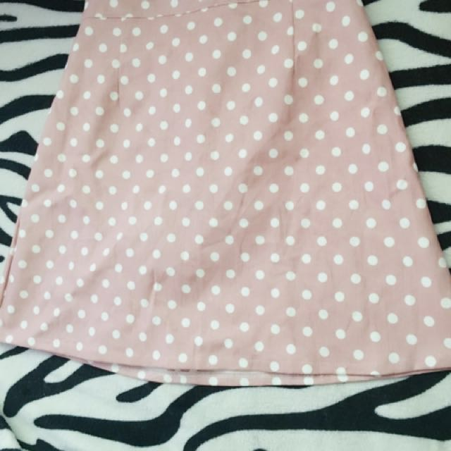 Pink skirt with white polka dots